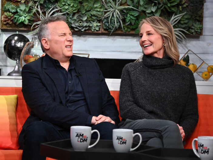 Paul Reiser, left, making a confused face on a talk show with Helen Hunt.