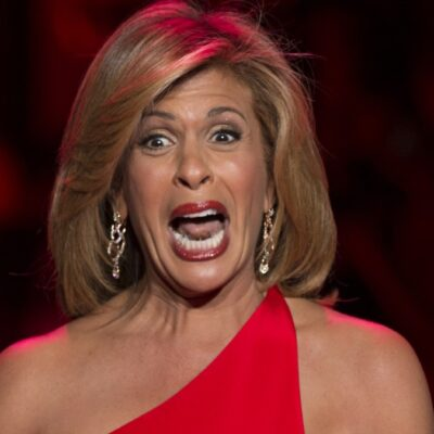 Hoda Kotb pulls a dramatic expression while walking the runway in a red dress