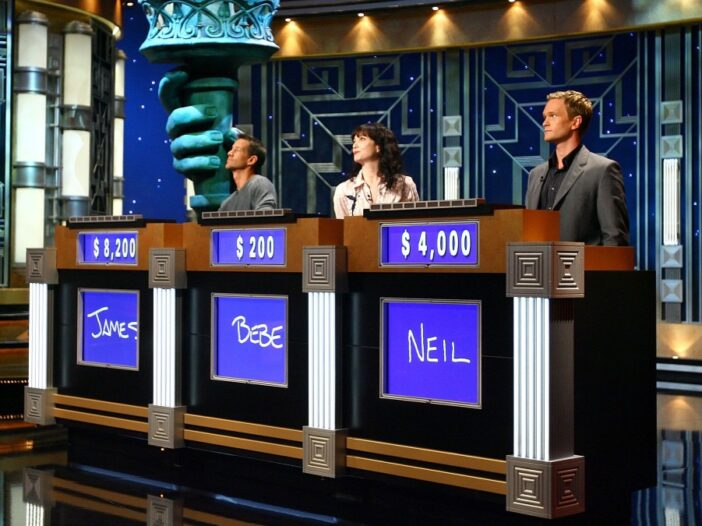 An onset photo featuring three celebrity contestants, including Neil Patrick Harris