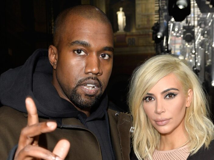 Kanye West gestures while standing with then wife Kim Kardashian
