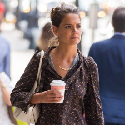 Katie Holmes wears a brown outfit as she walks down the street