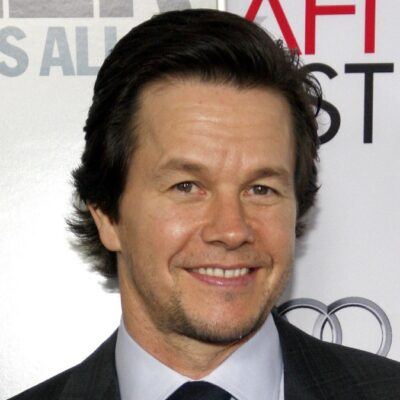 Mark Wahlberg wears a dark suit to a film premiere