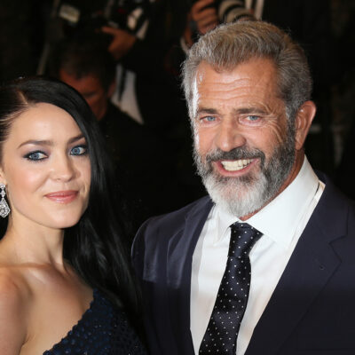 Mel Gibson on the right, standing with girlfriend Rosalind Ross