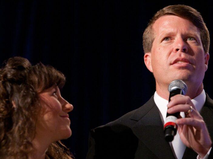 Michelle Duggar gazes up at husband Jim Bob as he delivers a speech