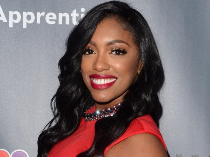 Porsha Williams wears a red dress on the red carpet