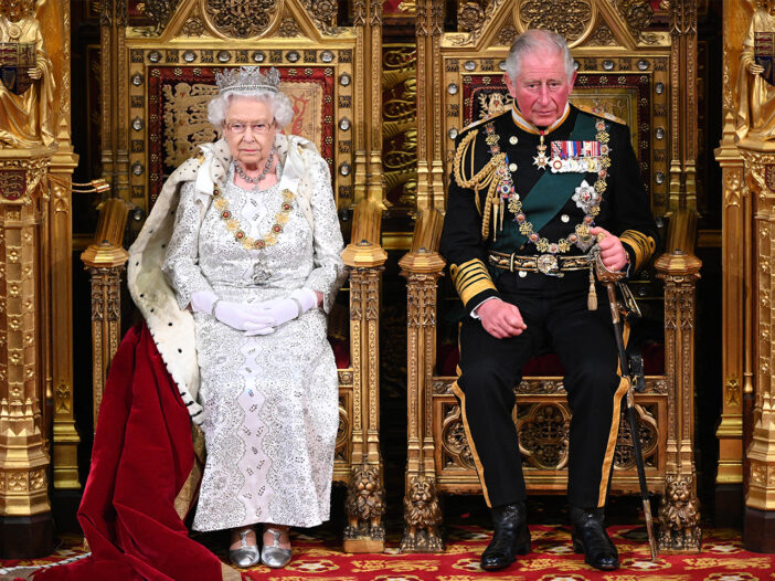 Queen Elizabeth and Prince Charles sitting on Thrones at the opening of Parliament