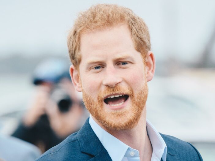 Prince Harry calls out to someone in the crowd while visiting New Zealand