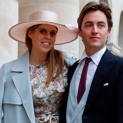 Princess Beatrice, in a floral dress and blue coat, stands with Edoardo Mapelli Mozzi at a royal event