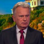 Pat Sajak in a suit on Wheel of Fortune