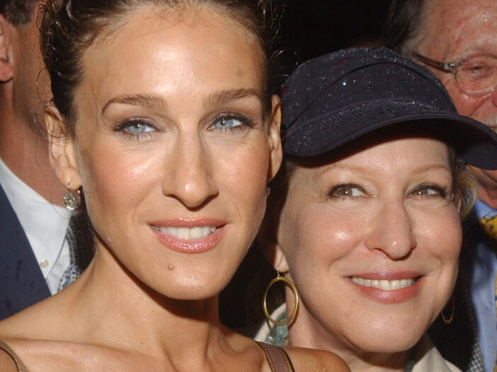 Close up of Sarah Jessica Parker on the left and Bette Midler, in a hat, on the right.