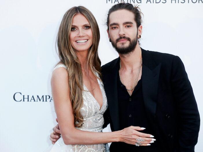 Heidi Klum smiling in a white dress with husband Tom Kaulitz