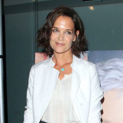 Katie Holmes in a white jacket and top