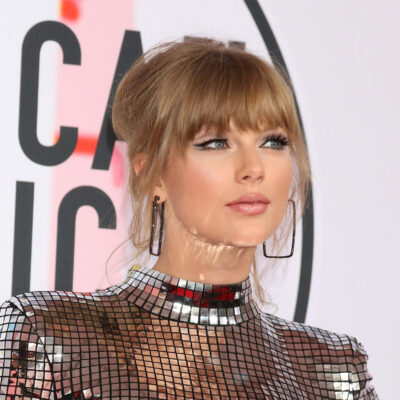 Taylor Swift in a reflective silver dress