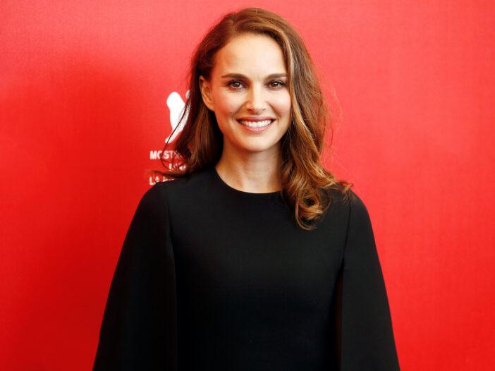 Natalie Portman smiling in a black dress