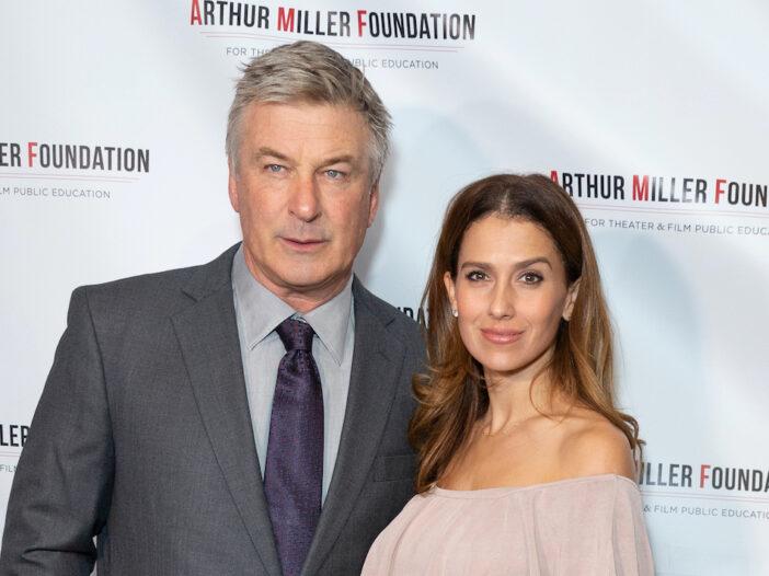 Alec Baldwin in a grey suit with Hilaria Baldwin