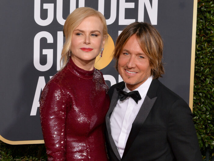 Nicole Kidman in a red dress with Keith Urban in a tuxedo