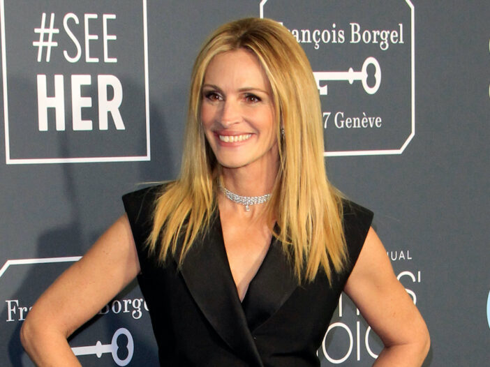 Julia Roberts smiling in a black blouse