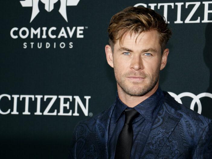 Chris Hemsworth in a navy suit