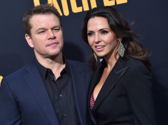 Matt Damon in a navy suit with wife Luciana Barroso in black