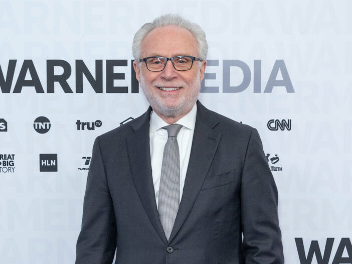Wolf Blitzer in a grey suit smiling