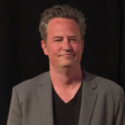 Matthew Perry in a jacket and shirt