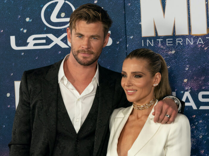 Chris Hemsworth in a suit with wife Elsa Pataky in a white pantsuit