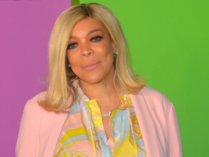 Wendy Williams smiling in a pink cardigan