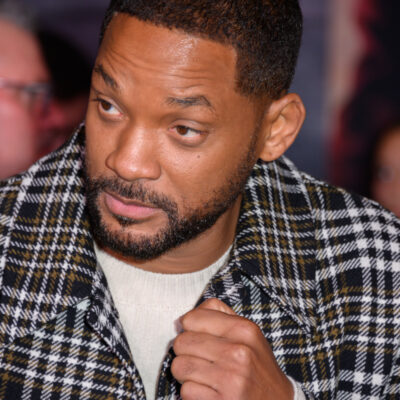 close up of Will Smith in a plaid jacket