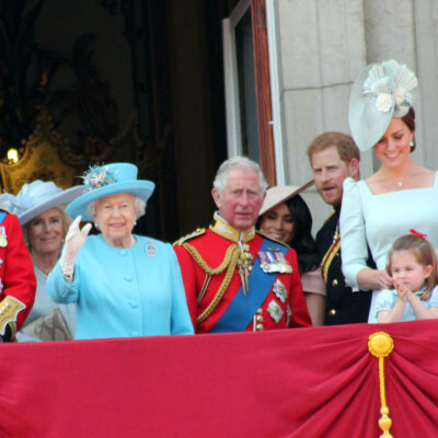 the royal family standing in a balcony