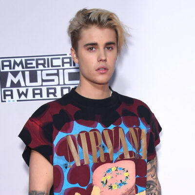 Justin Bieber in a red and black tee