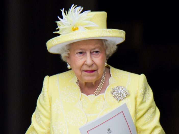 Queen Elizabeth in a yellow outfit