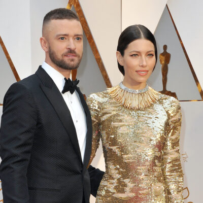 Justin Timberlake in a tuxedo with Jessica Biel in a gold dress