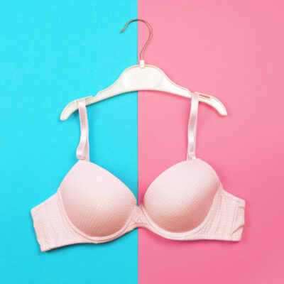 Cover image of a bra on a colorful background.