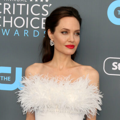 Angelina Jolie in a white dress smiling