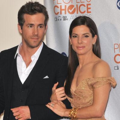 Sandra Bullock and Ryan Reynolds arm in arm