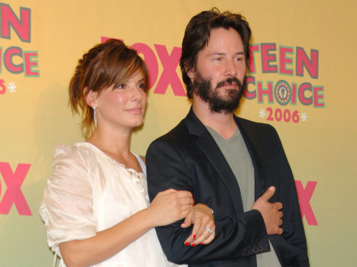 Keanu Reeves and Sandra Bullock arm in arm in 2006