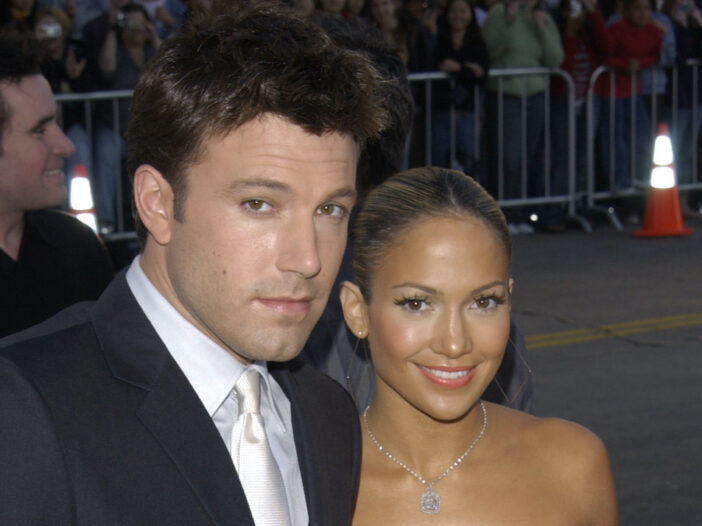 2003 photo of Ben Affleck in a suit with Jennifer Lopez in a dress