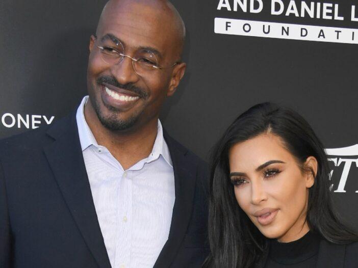 Van Jones, in a black suit, poses next to Kim Kardashian, also dressed in black