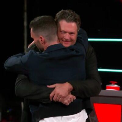 screenshot of Adam Levine hugging Blake Shelton on the voice