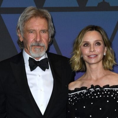 Harrison Ford in a tuxedo with Calista Flockhart in a black dress