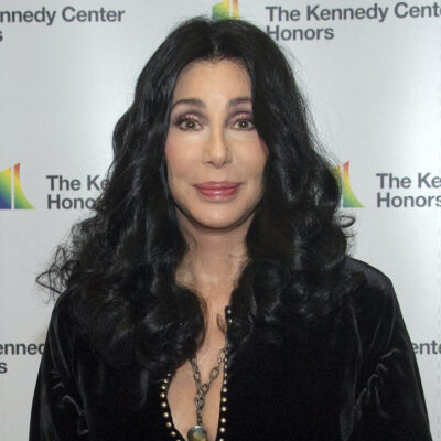 Cher in a black top smiling