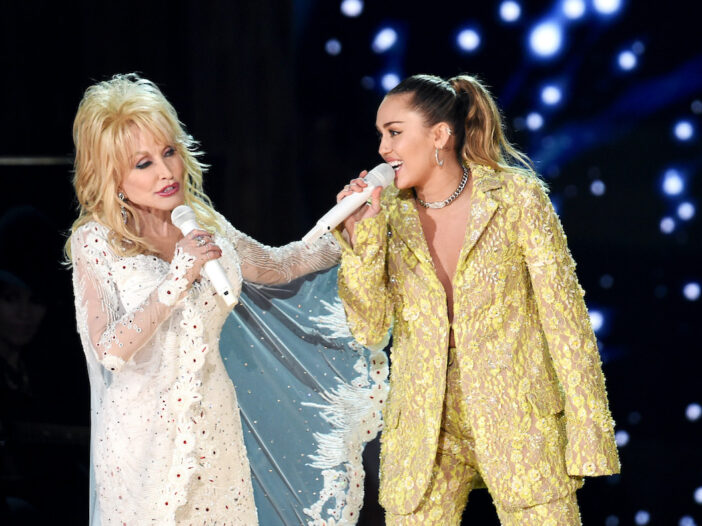 Dolly Parton singing on stage with Miley Cyrus at the Grammys