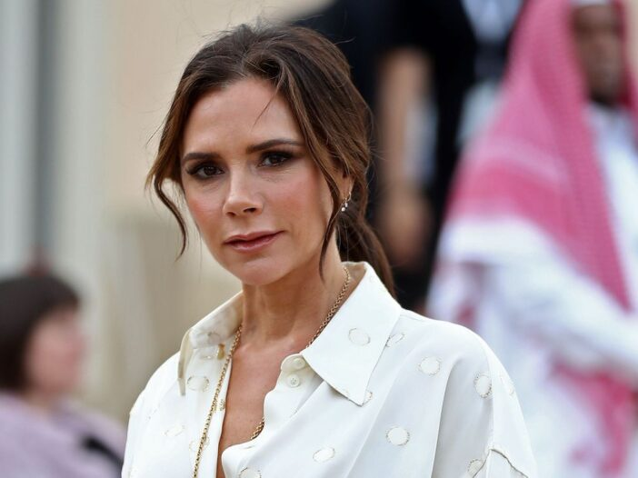 Victoria Beckham in a white blouse