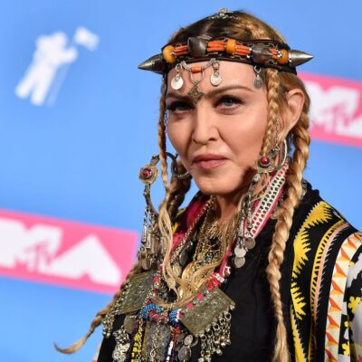 Madonna in a gold outfit and headpiece