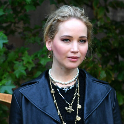 Jennifer Lawrence in a black leather coat and outfit