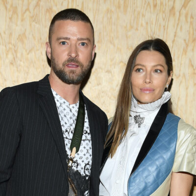 Justin Timberlake and Jessica Biel standing together in front of wood