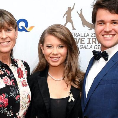 Bindi Irwin standing between Chandler Powell and Terri Irwin