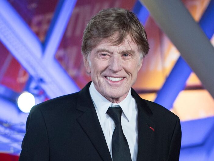Robert Redford smiling in a suit