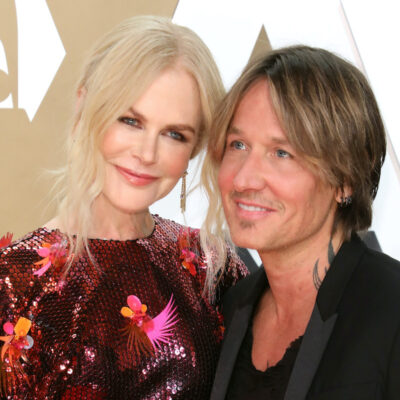 Nicole Kidman in a red dress with Keith Urban in a black suit
