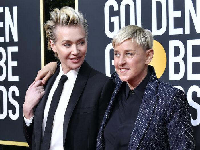 Portia de Rossi holding hands with Ellen DeGeneres